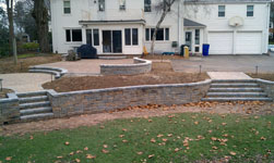 Retaining walls with patio and planting areas