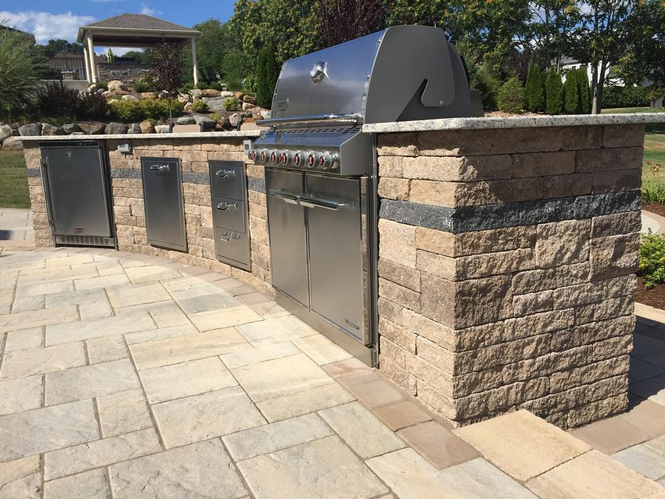 Patio with outdoor kitchen in Weatogue CT